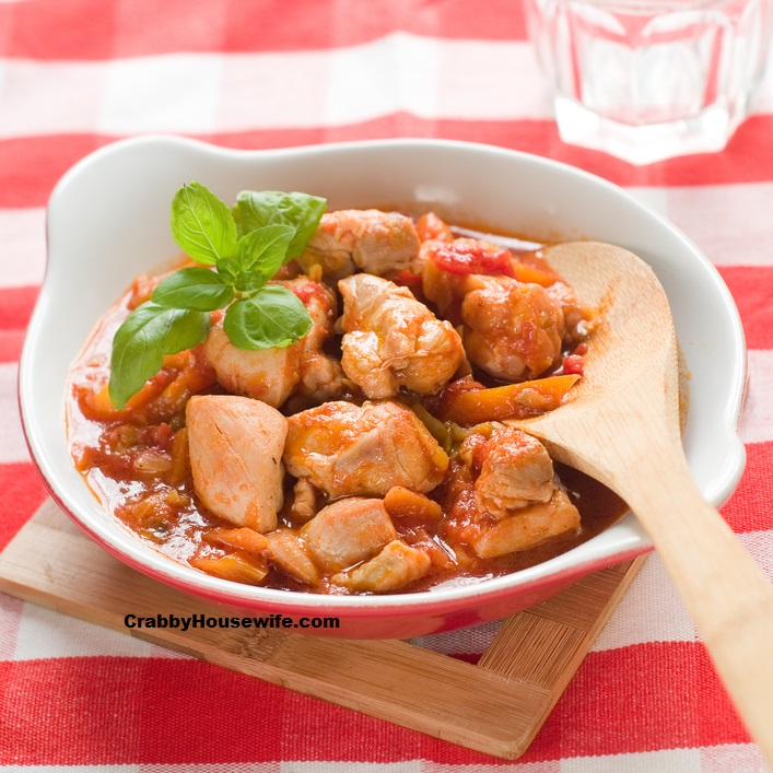 Provencal chicken stew with pepper ant tomato, selective focus