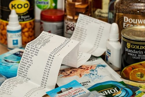 grocery receipt sitting in front of a table full of groceries