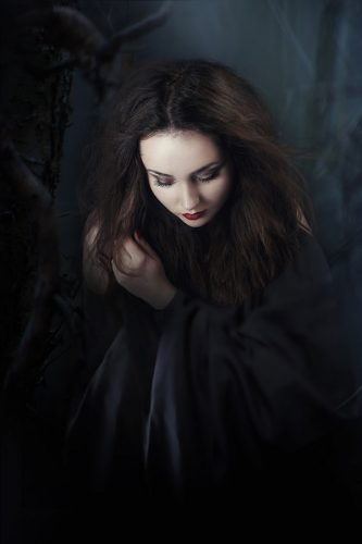 image of a girl in dark gear, reminiscent of one of the vampires in the Twilight Saga books.
