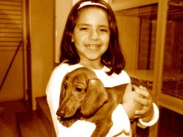 child with dachshund