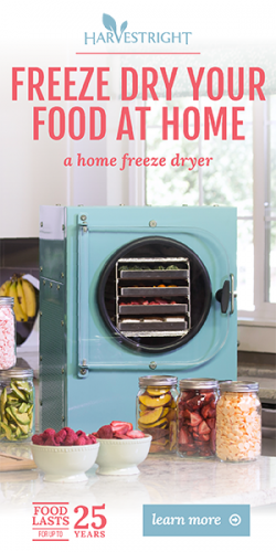 affiliate ad for harvest right, home food freeze dryer. The food dryer is a powder blue and there are some dried foods nd fresh berries in bowls and jars in front of the dryer.
