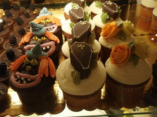 easy halloween cupcakes with coffins and witches on top.