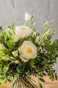 a pretty, simple arrangement of sympathy flowers for a funeral.