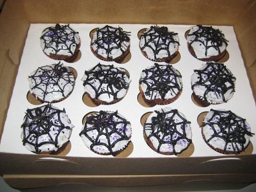 Vanilla cupcakes with spider web icing on top. Box of 12.