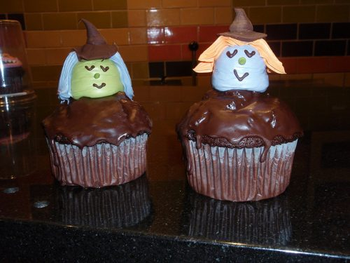 Mouth-watering chocolate cupcakes with marshallow witches on top.