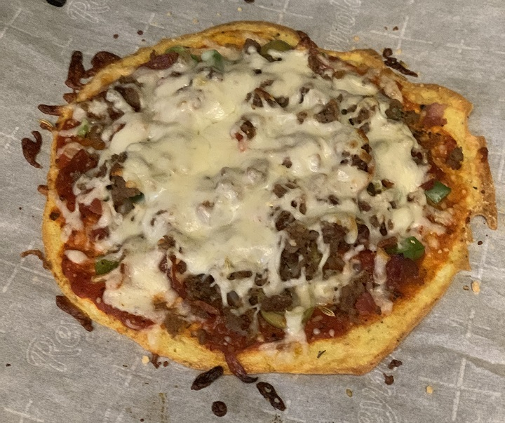 The crust on this personal low carb pizza turns out crispy and firm.